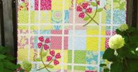"""Quilt Name: Pretty in Pink.Fabrics: by Heather Bailey from her Pop Garden and Bijouxl fabric lines for Free Spirit. I like this quilt for many reasons �€"""" one being that it has no borders."""