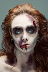 I think this make-up has been to done to create a simple look of a zombie, which is very effective. I like the way they have brought the brown eye shadow in-line with the middle of her nose to hollow the eyes out.