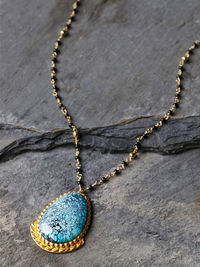 Handmade in Los Angeles, this beautiful necklace is perfect for making a stunning statement. Featuring an Arizona Turquoise pendant on a delicate gold chain. Lobster clasp closure.