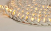 Crocheting around rope light to make an outdoor floor mat - This is cool,... now if only I knew how to crochet!