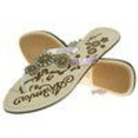 Akademiks Women `s Underground Sandals (Purple) Step out of the house in style with these sandals from Akademiks women. Features metallic leather straps and bronze flowers. Fabric: 100% Genuine Leather and Man made materials. http://www.compar...