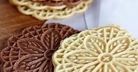 My husband has been begging me to make pizzelles for weeks, telling me all about how his grandmother made them every year for Christmas. How an Italian cookie b
