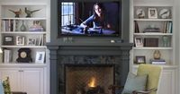 Painted fireplace w/ built-in Tv