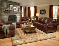 Living Room : Fireplace With Picture Frame Also Brown Fabric Curtain And Brown And Beige Round Rug Besides Brown Leather Sofa Natural Varnished Wooden Floor White Fabric Square Table Lamp Leather Sofas - Reclining Comfort on Family Space Leather Couch And...