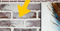 """How to do a german smear or """"mortar wash"""" DIY brick whitewash on your brick fireplace or other brick surfaces. This DIY project is inexpensive & easy to do!"""