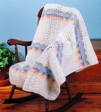 Basket-weave Baby Afghan: Baby will bask in the warmth of this blanket of intertwined rainbow shades.