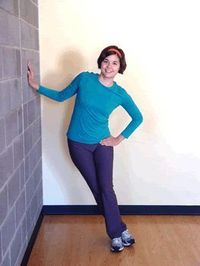Learn how to safely do Standing IT Band Stretch with Wall