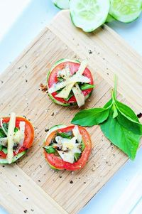 Cucumber Basil Bites 1 large cucumber, sliced into 1/4 inch rounds 2 Roma tomatoes, cut into 1/4 inch rounds 4 large, fresh basil leaves, diced 1/3 cup Gouda cheese, shaved into ribbons 3 Tablespoons Balsamic Vinegar Kosher salt and cracked black pepper, ...