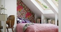 I love the smallest wall covered with a bright, bold, graphic print wallpaper (gives a headboard appearance), also love the windows!