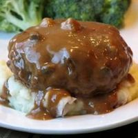"Slow Cooker Salisbury Steak | ""Ground beef gets a boost of flavor from onion soup mix in this quick and easy slow cooker Salisbury steak recipe."""