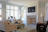 Framing the TV above the mantle <3 the wainscoting 3/4 way up the wall, the molding and the ceilings!