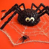 Sculpt this adorable spider cake using a super sized cake ball and serve it at your Halloween party.