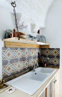 A stunning tile backsplash and a rustic shelf | via