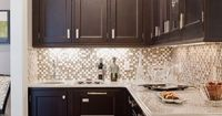Today's kitchen & bathroom backsplashes are as decorative as they are functional. Discover materials & styles to help you choose the right backsplash here!