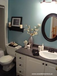 The current paint color is Tranquil Blue by Benjamin Moore. I love the black and white scheme of this room.
