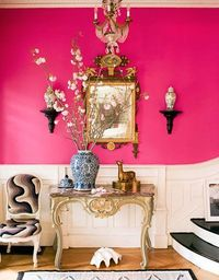 The entry of a late-19th-century house in Brooklyn is a showstopper, with walls in Benjamin Moore's Razzle Dazzle.