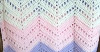 Baby afghan in pink, lilac, and white.