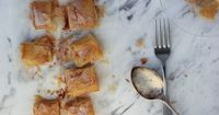 �€œBougatsa�€ is a Cypriot dessert. It is an orange-blossom and lemon semolina custard encased in filo and dusted with cinnamon and icing sugar.