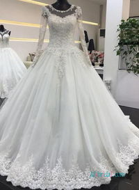 Romantic long-sleeved ball gown #weddingdress