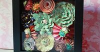 Paper flowers shadowbox - I wonder if I could do this with crocheted flowers