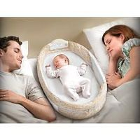 Baby goes from warm snug womb, to big wide world. Snuggle Nest keeps her close to u hubby (exactly how she's slept for the past 9 mos. you know, in your ever growing belly!) Baby Delight Snuggle Nest Surround - Babies R Us - $60