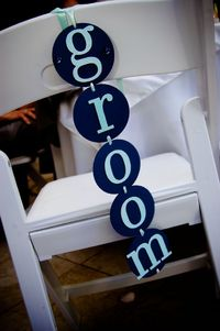 Groom's chair detail. Navy and light aqua, traditional wedding with nautical accents