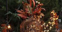 Fall Decorations: Designer Melissa Valeriote modified a Grapevine Twig Pumpkin decoration from The Home Depot to be an enchanting outdoor fall lantern. Click through to see more of her gorgeous outdoor decorations. ||