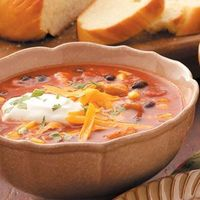 Mexican Chicken Soup 1-1/2 cups with 1 tablespoon each cheese and sour cream and 1 teaspoon cilantro equals 345 calories, 7 g fat (3 g saturated fat), 72 mg cholesterol, 1,315 mg sodium, 34 g carbohydrate, 7 g fiber, 31 g protein. Diabetic Exchang...