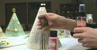 This is a tutorial on how to make a Holiday Tree from a paperback book: one paperback book with at least 150 pages, binder clips (large size work best), glitter paint or spray on glue and loose glitter, brushes (if using glitter paint), sc...