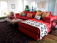 red couch, fun pillows, patterned ottoman
