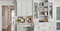 Kitchens by Deane: Stunning kitchen office with off-white cabinets with carrara marble countertops. ...