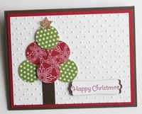 simple Christmas Card...Stampin' UP! DSP and Circle Punch...with the Perfect Polka Dot Embossing Folder for the Big Shot...small star punch and modern label punch finish off this cute and simple card.