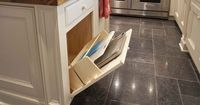 Wish I had seen this before renovation. Here's another storage surprise in the island: a base cabinet tilt-out designed to hold cutting boards and cookie trays.
