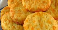 Australian Busters Recipe (One Perfect Bite) | Busters are savory biscuits or crackers that were given this unusual name because when eaten without caution they become belt busters. They are made from a cheesy dough that is very much like the doug...