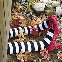"""Make this creepy outdoor Halloween witch decoration to create your very own """"witch landing"""" right on the lawn."""