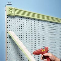 Pegboard is everywhere-panels, hooks, doodads, you name it. Every hand tool in the hardware store is hanging on pegboard. Every bag of bolts, roll of duct tape