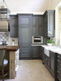 like the idea of gray washed cabinets with nickel polished hardware Color and simplicity.