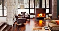 Yellow house on the beach: Two stylish homes and a fireplace in the atmosphere