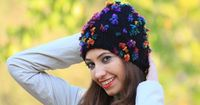 Knit hat with flower yarn