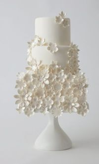 wedding cake with small white flowers