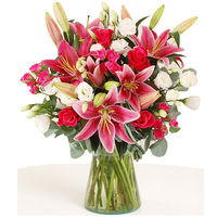 This is a really spectacular display of stunning roses and elegant scented Oriental lilies. To the bright cerise roses, our florists have added little pink spray roses, which echo the hot pink shade of the Oriental lilies, and then the clear white of the ...