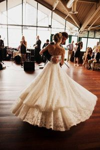 This girl's dress is beautiful...front and back. The whole wedding is beautiful.