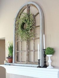 spring mantle..old white arched window frame sitting on mantle or other accessories...