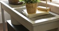 Build a cottage-style, shutter console table for your living room with these instructions at HGTV.com.