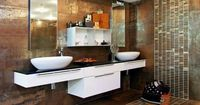 Subway tiles arranged in a runner pattern add modern dimension to this rust-colored bathroom.