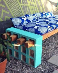 Don't want to spend a lot of money on a sofa for your patio or garden? Consider making your own, using the photo above as a guide. You'll need some cement blocks, cement paint, wood beams, a long cushion for seating and several smaller ones fo...