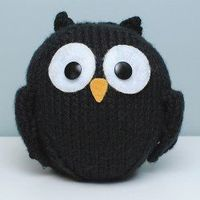 Free knitting pattern for stuffed black owl toy.
