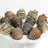 One dozen perfectly ripe, juicy strawberries that we've hand-dipped into luxurious white, milk, and dark Belgian chocolates, then elegantly embellished with thin ribbons of chocolate drizzle. Quantity: 6