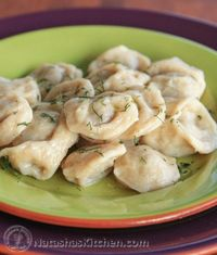 Serve these Russian Pelmeni in a good quality chicken broth, or boil and butter them up, then dip in sour cream, vinegar or ketchup.