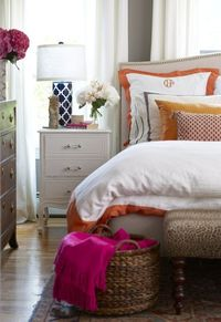 love the sweet white bedside table w/the graphic lamp, soft headboard, leopard bench, hot pink blanket & orange accented bedding...